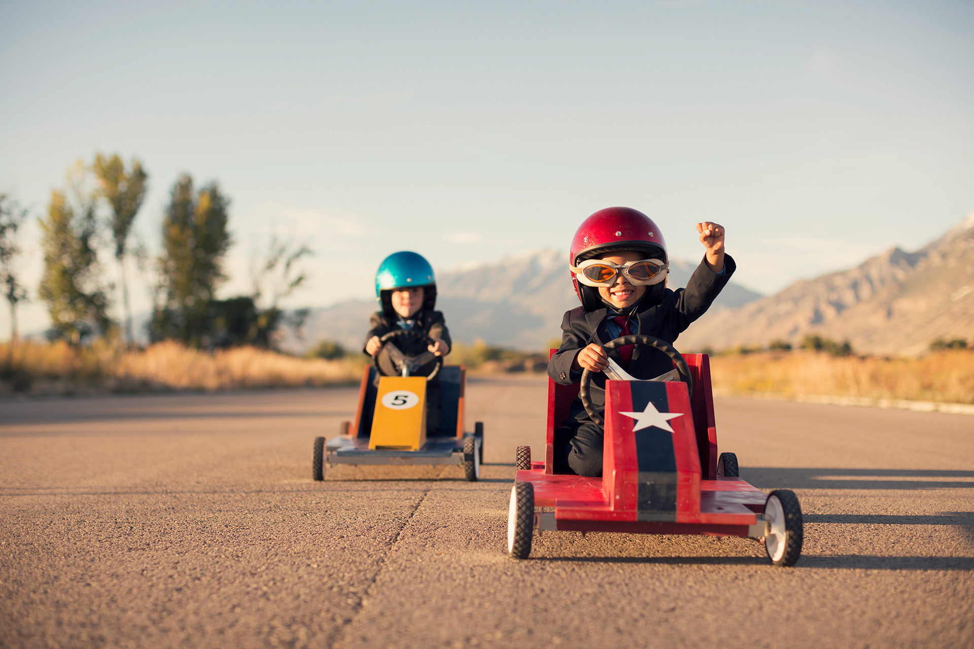 Young-Business-Boys-in-Suits-Race-Toy-Cars-507282334_5760x3840-1920x1280